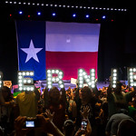 Supporters hold signs while waiting for Vermont senator Bernie Sanders to take the stage for a rally at the Verizon Theater on Thursday, April 20, 2017, in Grand Prairie, Texas. Sanders, the ...