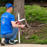 Tim Dougherty places crosses along Greenville Avenue before pro-life advocates held a Good Friday vigil outside the Southwestern Women?s Surgery Center on Friday, April 14, 2017, in Dallas ...