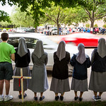 Pro-life advocates line the sidewalk in prayer as traffic passes on Greenville Avenue during a Good Friday vigil outside the Southwestern Women?s Surgery Center on Friday, April 14, 2017,  ...