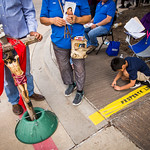 Pro-life advocates stay behind a property line marker as they hold an annual Good Friday vigil outside the Southwestern Women?s Surgery Center on Friday, April 14, 2017, in Dallas. (Smiley ...