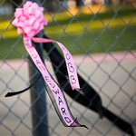 A ribbon bearing his name flutters from a fence during the