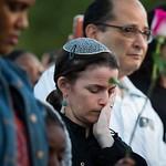 Rabbi Elana Zelony bows her head during the